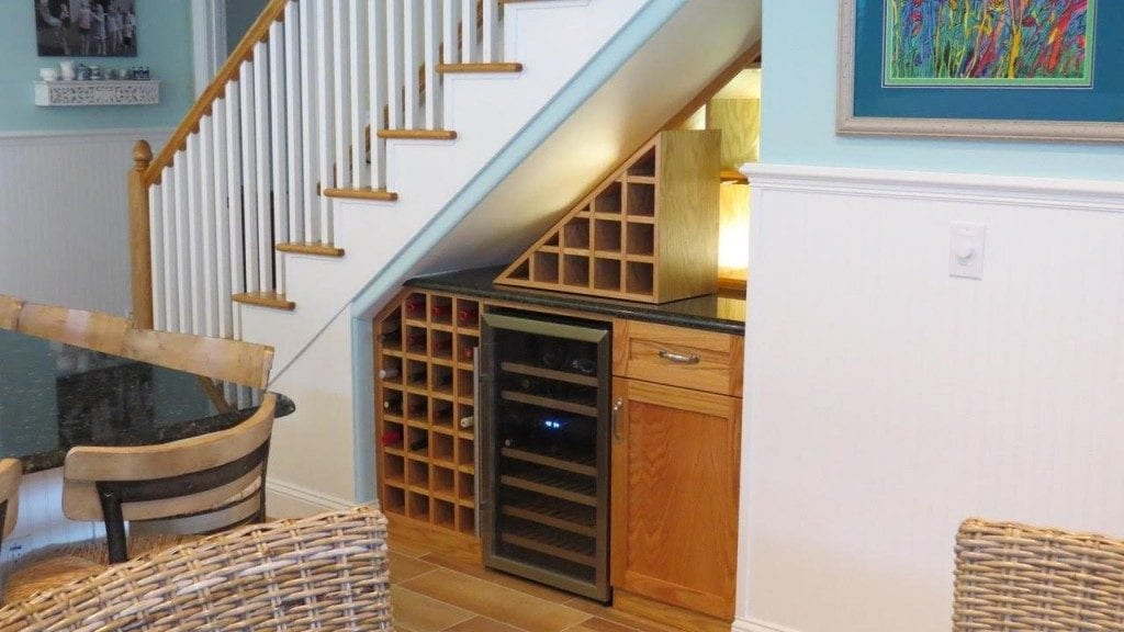 After: Functionally beautiful space. Notice how the triangular wine rack slides